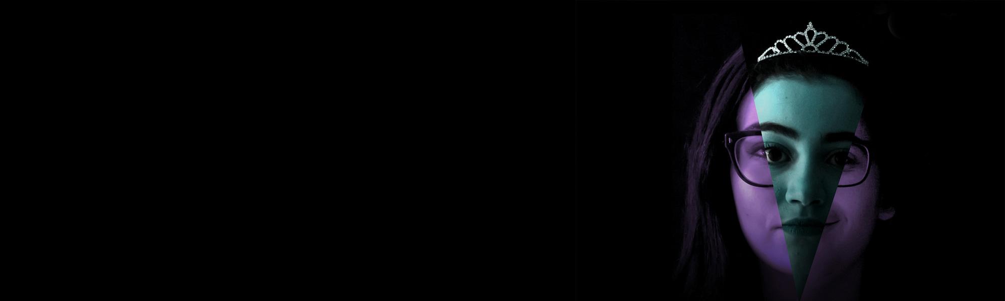 Teenage girl on dark background