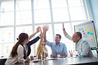 Four people in an office as a team