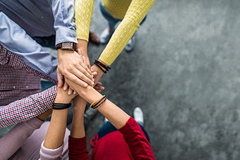 A group of people's hands to show collaboration