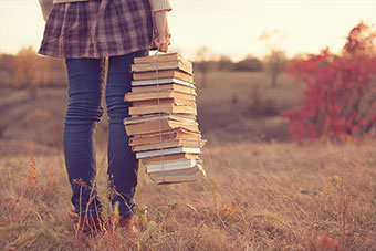 A person holding some books